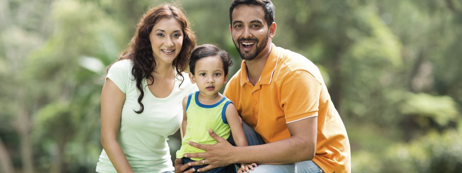 daudlin law banner portrait of happy family outdoors